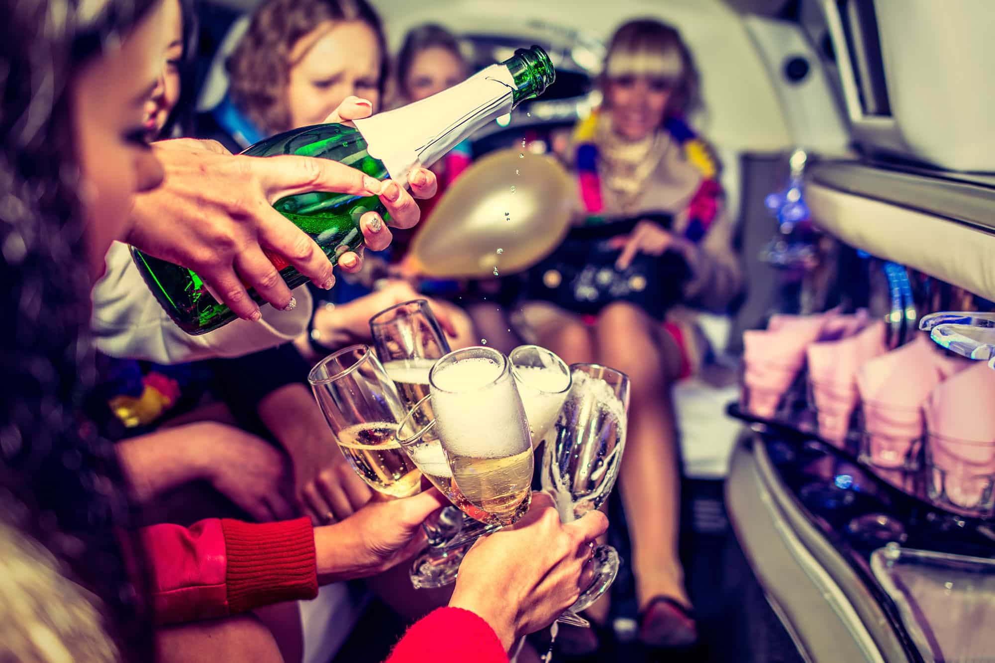 Group of bachelorette party in the limousine in Warsaw during the limo party tour gdansk