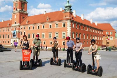 Group of people on segways at the tour next to the Royal Castle