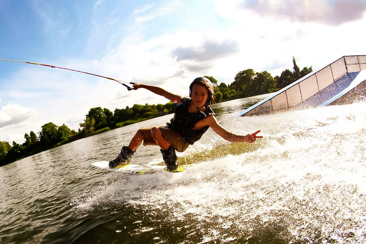 Person having fun at the wakeboard experience in Warsaw