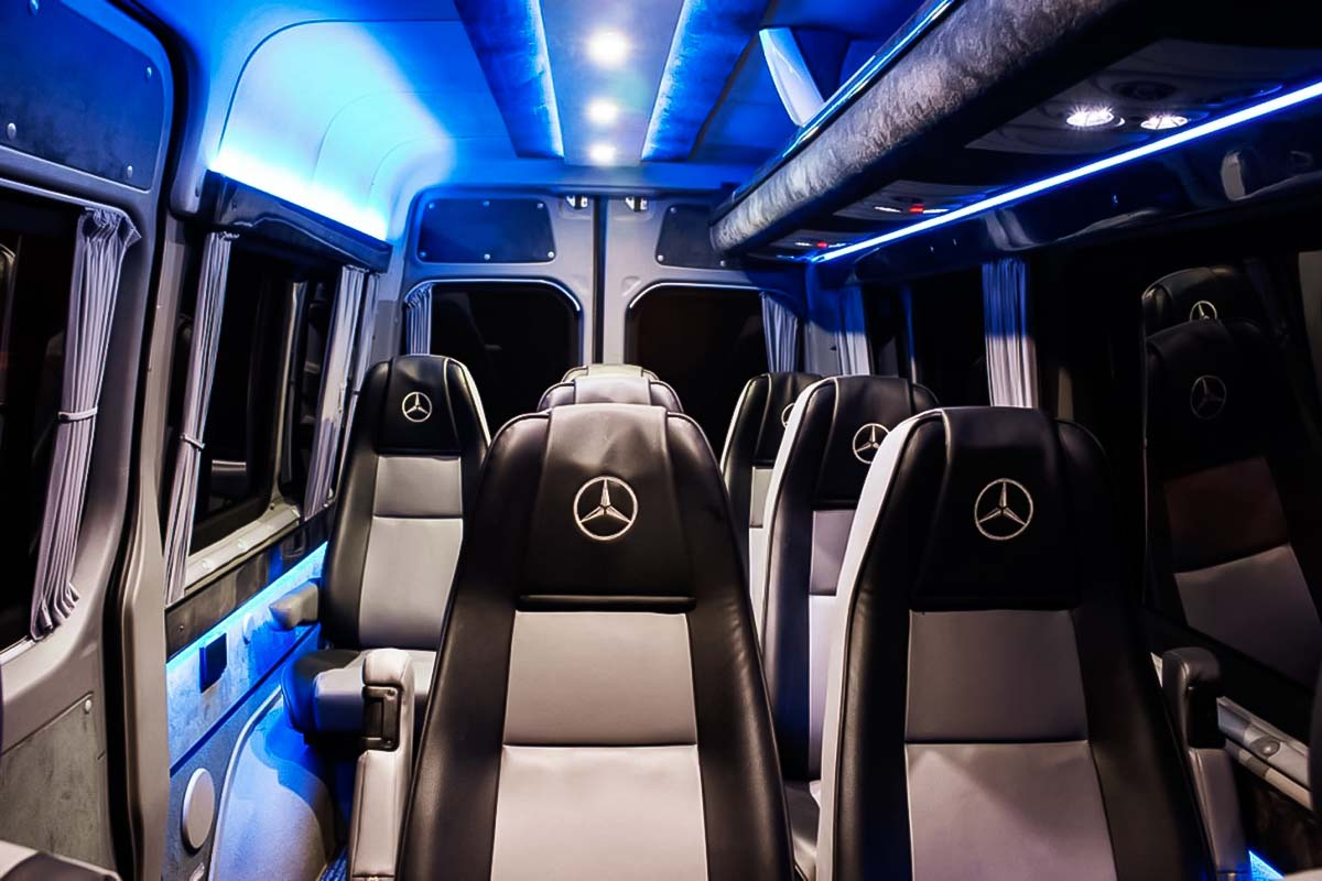 Blue VIP lights light up interior of mercedes sprinter vip car that provides group warsaw modlin or chopin transfers
