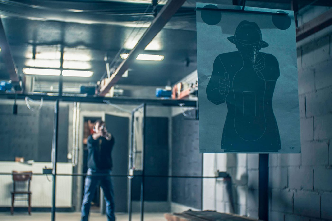 Gun shooting range with a man standing behind