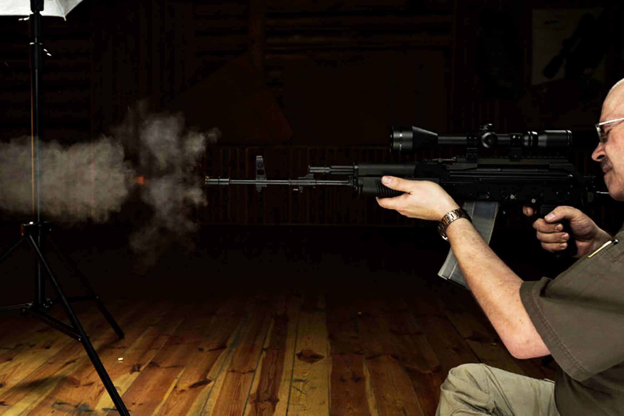 Man shoots a Kalashnikov gun during activity in warsaw