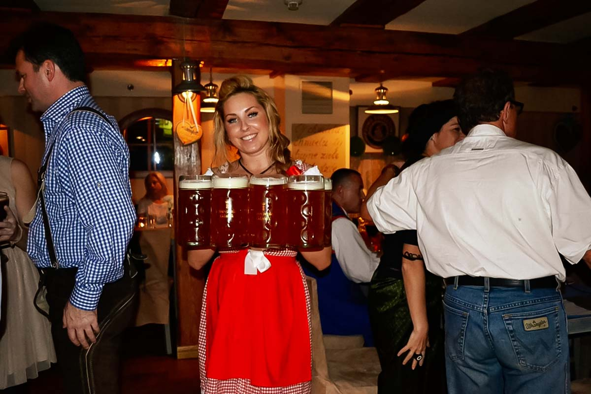 Gorgeous waitress with handful of beers giving a taste of local culture at the beer tasting tour in Gdansk