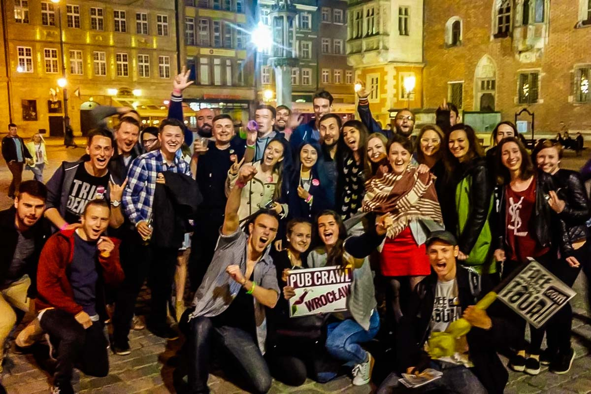 Big group of international people enjoying the evening on the party tour in Wroclaw