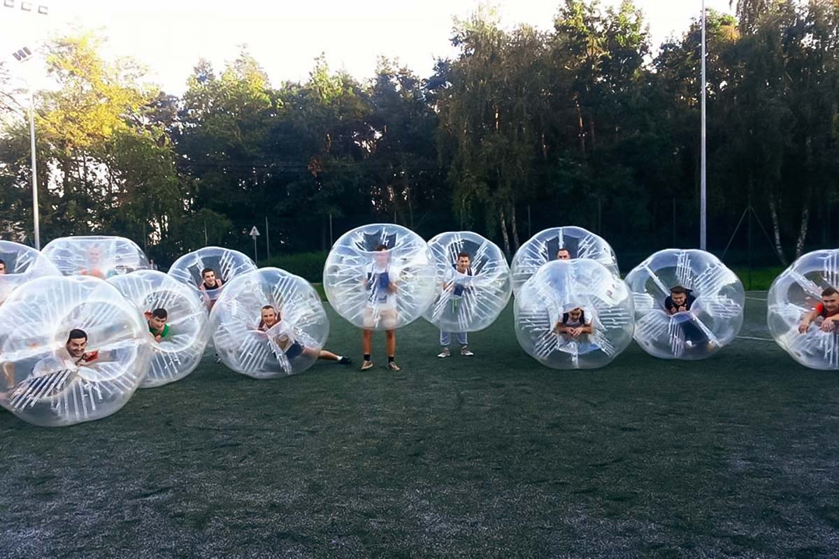 Be like this group of people and play bubble football in Poznan with us