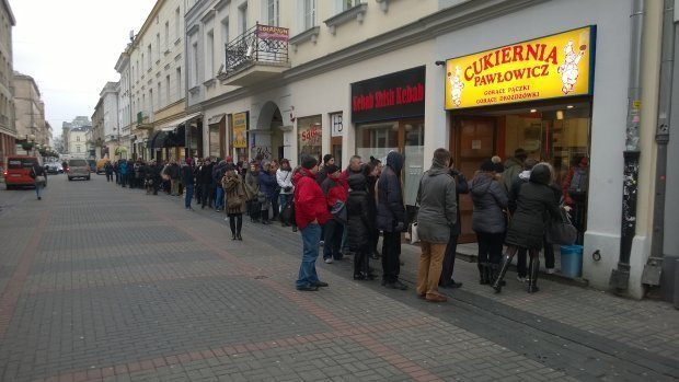 huge line in front of the bakery on the fat thursday in warsaw