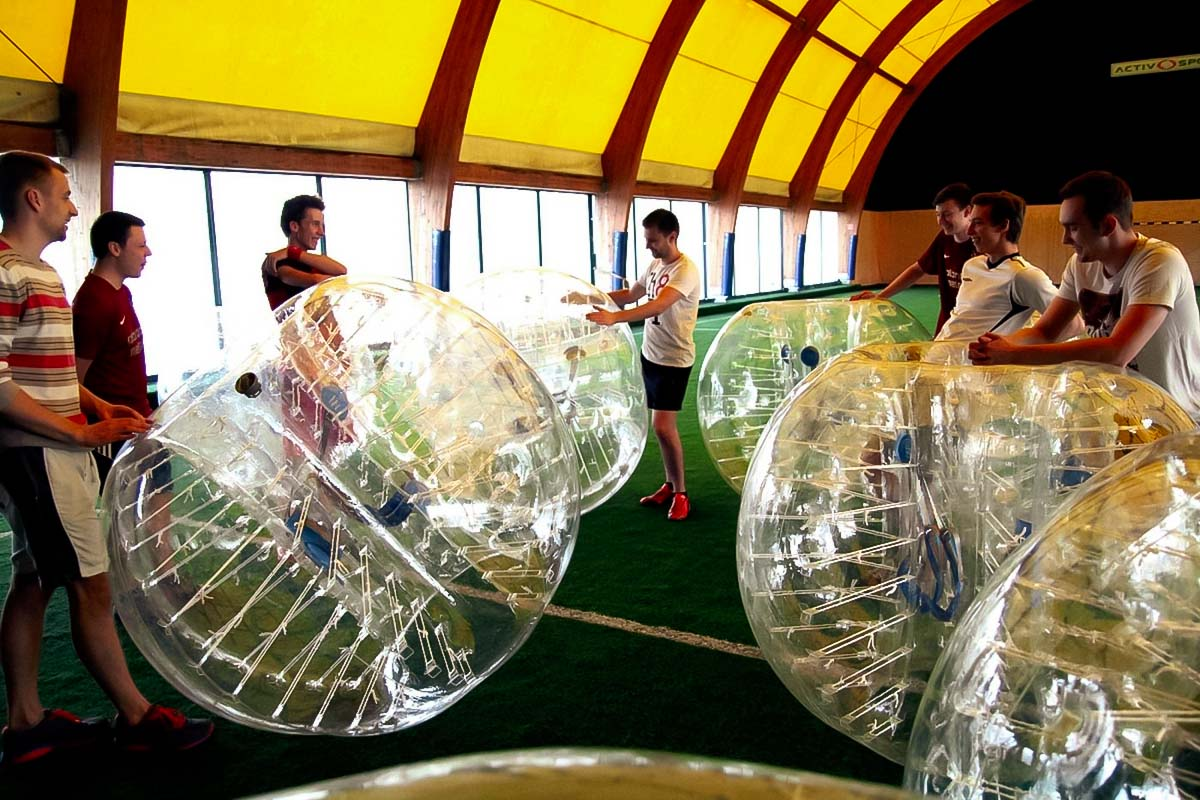 Group playing indoor bubble football