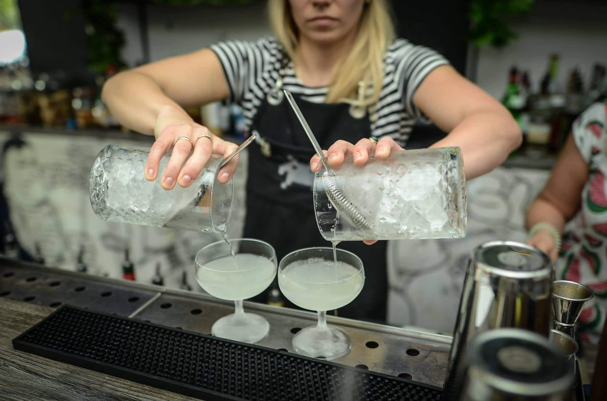 Girl double pouring at the cocktail workshop